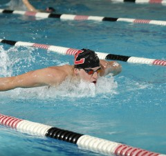 Photo by Steve Woltmann Brandon Thomon set the school record at the House of Champions event.