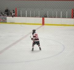 Photo by David Ridderhoff Defenseman Nick Santelli skates through the neutral zone against Augustana.