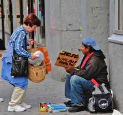 Photo courtesy of Ed Yourdon, Wikipedia user Two women on the Broadway Street in New York City bring a homeless man some lunch in an effort to spread love and understanding.